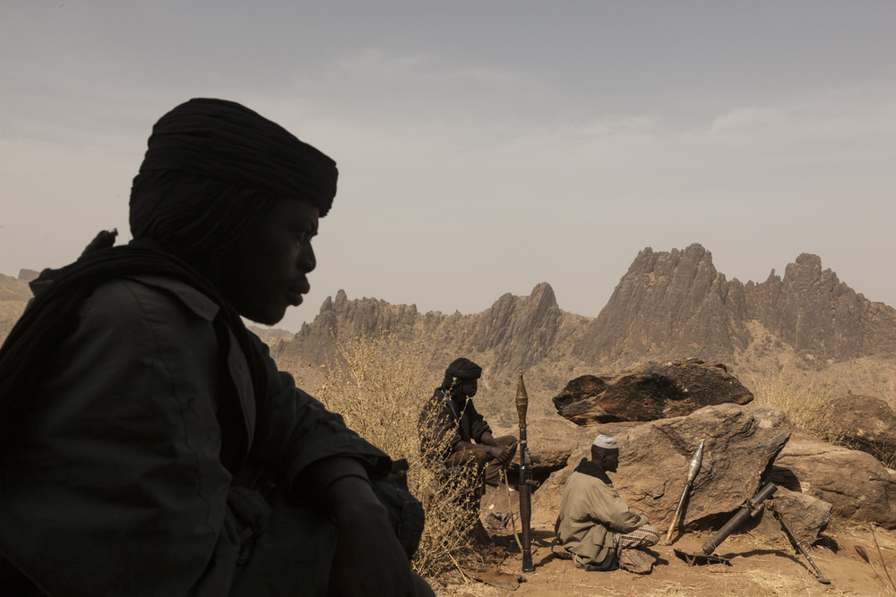 Members of the rebel group the Sudan Liberation Army, led by Abdul Wahid (SLA-AW), sit on a mountain top that they are defending from the Sudanese Army in Central Darfur, Sudan, March 4, 2015.