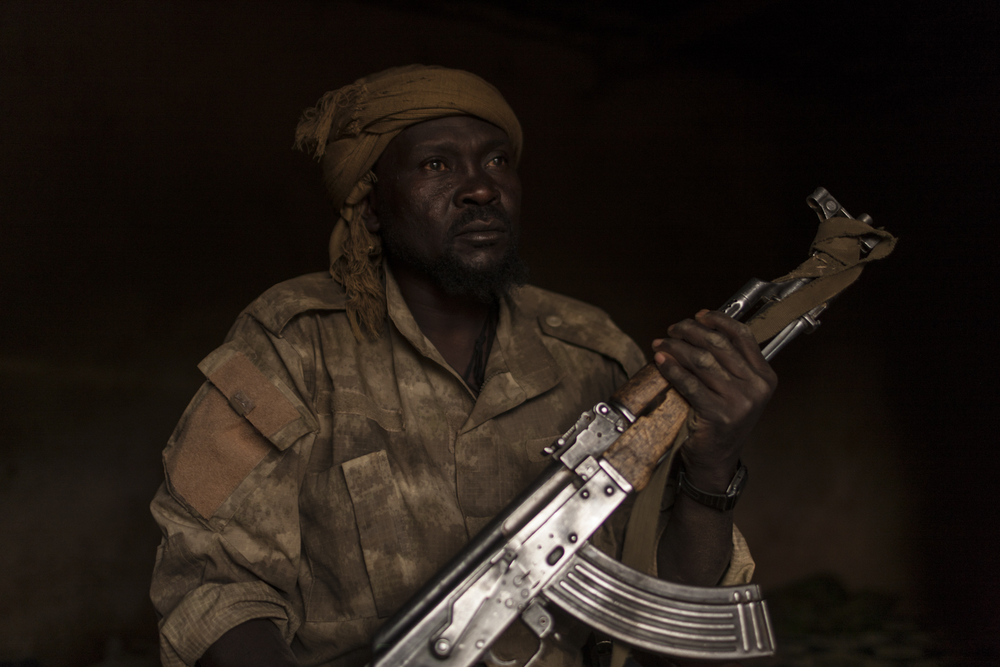 Ali Osman, who was originally part of the Sudan's government forces, now fights with the SLA-AW rebel group as a sniper, sits for a portrait in Central Darfur, Sudan, March 3, 2015.