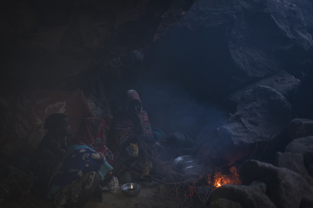 Women make tea next to where they sleep in a cave above the town of Sarong in Central Darfur, Sudan, March 2, 2015.