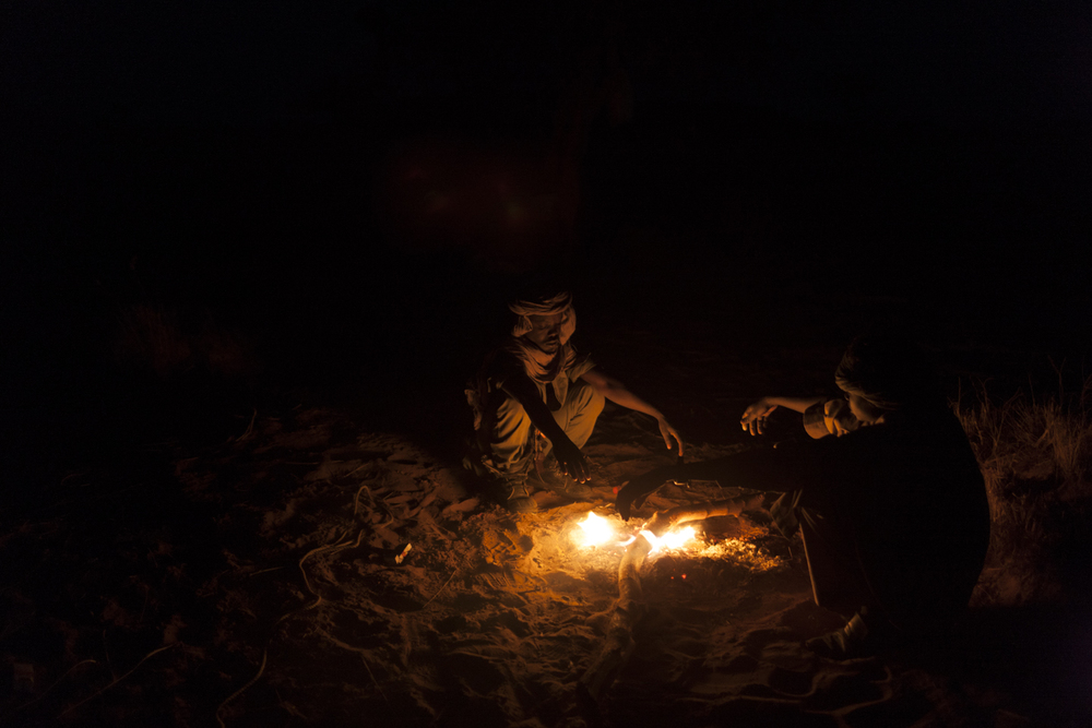 Rebel soldiers from the Sudan Liberation Army - Abdul Wahid (SLA-AW) keep warm by a fire outside of their camp in North Darfur, Sudan, February 22, 2015.