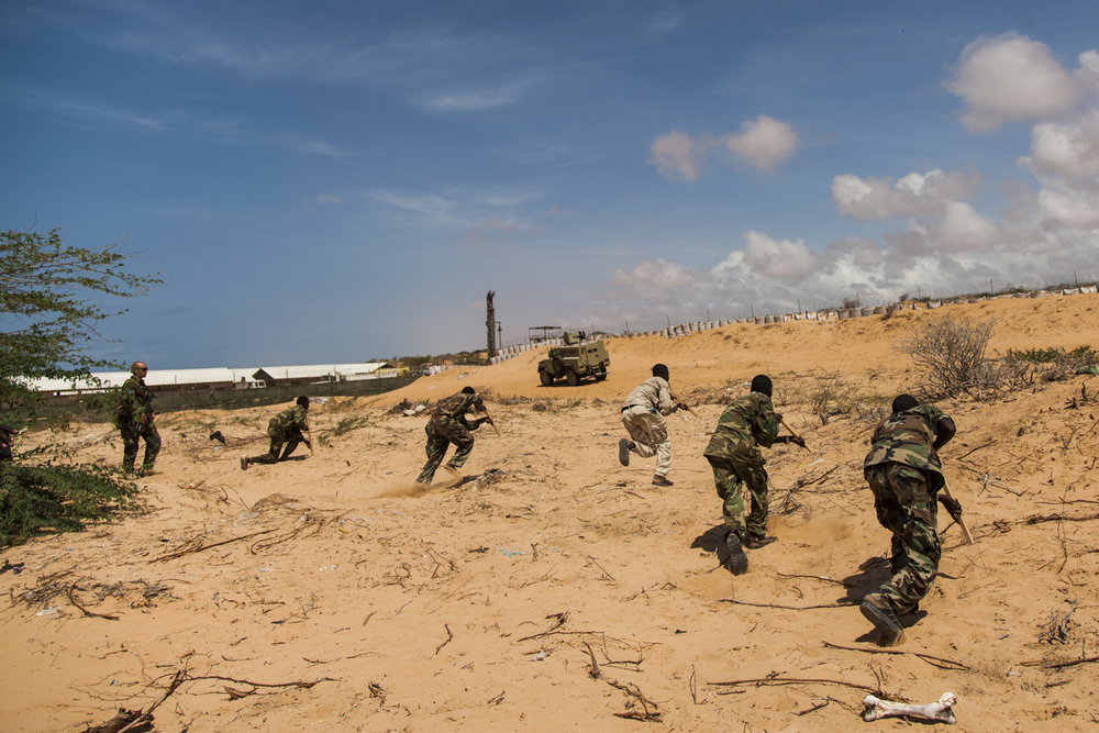 Members of the Somali National Army complete a drill under the guidance of the European Union at the Jazeera Training Camp in Mogadishu, Somalia, May 1, 2014.