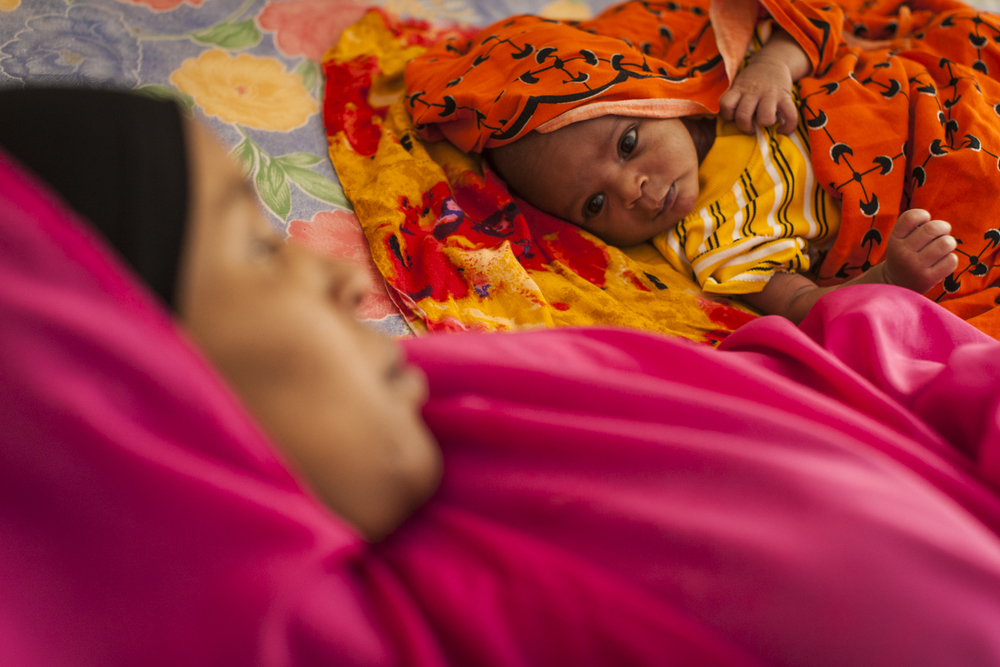 Amina, age 30, rests with her newborn son Abdi in the Dr. Alag Maternal and Child Health Center in Burao, Somaliland, November 12, 2014.