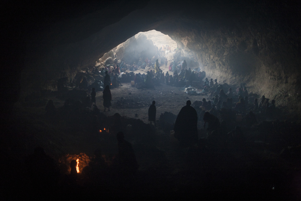 Hundreds of women and children seek shelter in a cave from the bombing by the Sudanese government's forces in Central Darfur, Sudan, March 2, 2015.
