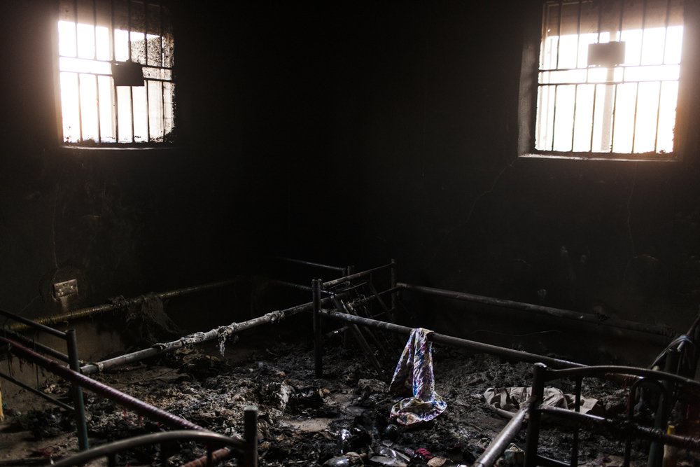 On December 16 SPLA government soldiers looted and burned Nuer houses in the Juba neighborhood of Munuki West, South Sudan, January 19, 2014. A year later the area is still abandoned as the civilians remain inside of the UN bases.