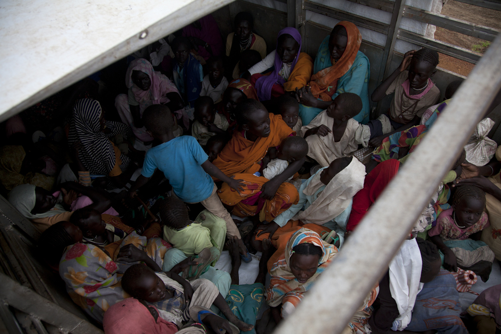 Women and children pile into the back of a truck that will take them from Jamam refugee camp to Yusuf Batil refugee camp in Upper Nile, South Sudan, July 2nd, 2012.