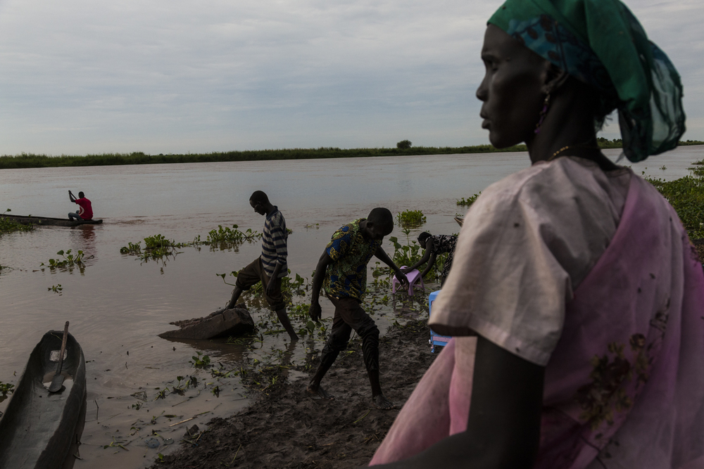 Early morning activity on the bank of the Sobat River, outside of the fish market in Nasir, Upper Nile, South Sudan, September 6, 2013.