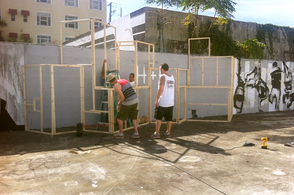Haas&Hahn at work on their 3D mural: favela houses constructed from plywood