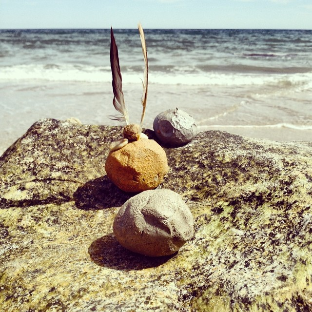 "a beautiful pic snapped by my friend of everyone's clay orbs as they dried on a rock deemed ""tomato island"" by the kiddos."