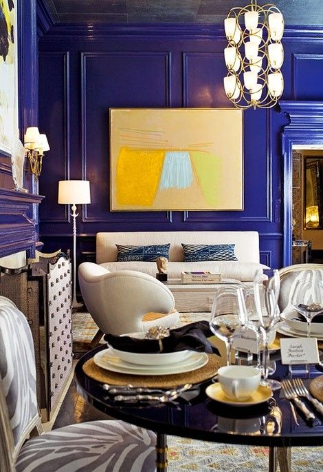 Cobalt makes a dramatic statement in this room and is perfected complimented by the bright yellows, warm grey tones, and white.