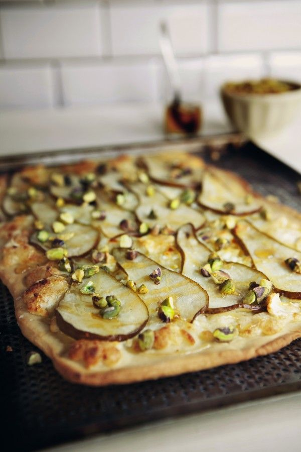 I make this Florentine style thin crust pizza with fresh pears, pistachios, and Miele honey from Italy. It is the perfect balance of savory and sweet.