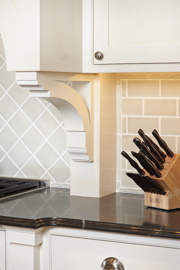 Celadon tile, soapstone, and a fretwork tile border.