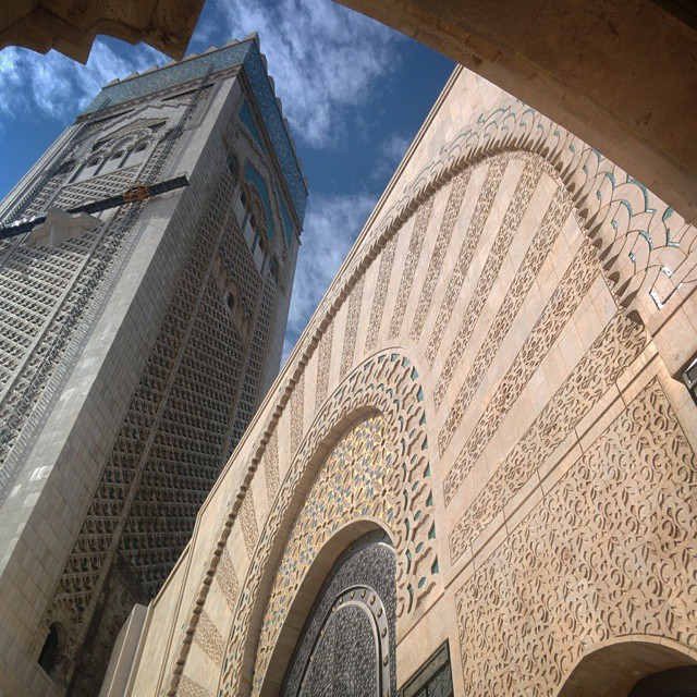 From our #neighborhoodlove series.  A dizzying view of the Hassan 2 Mosque. Travel differently this year seeing and experiencing in a new way. Bold colors, beautiful architecture, and the same mystique feel makes us your next destination! Come visit and share your own pictures with us. #tourism #travel #travellove #weloveourguests #discovermorocco #discovercasablanca #travelandlife #hotelstuff #diwantraveler