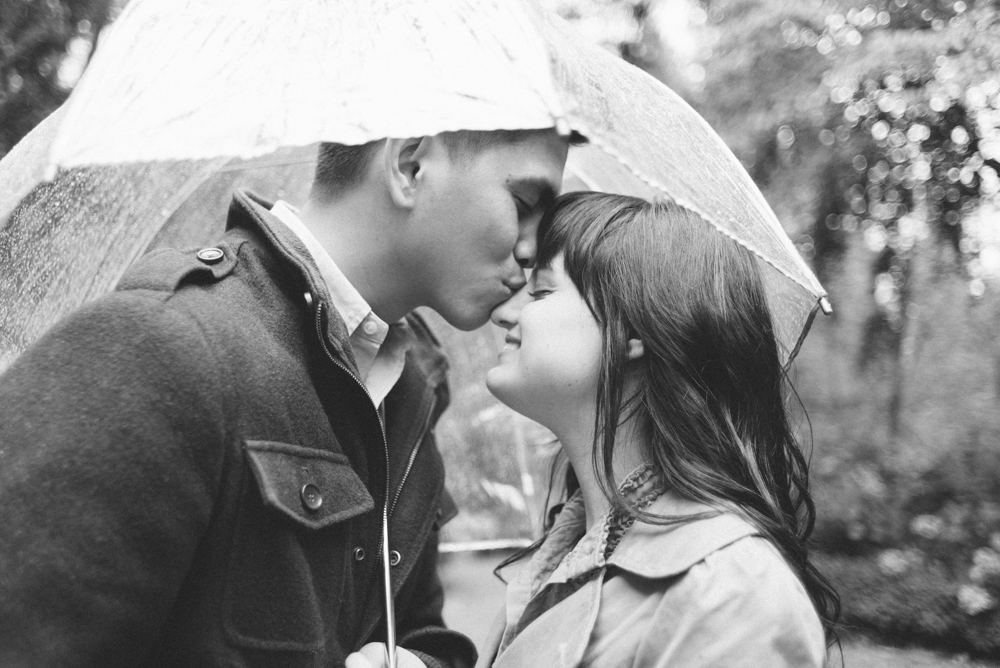 Leach-Botanical-Gardens-Couples-Engagement-Photography-umbrella-rain-kissing-Johan-Dani_0307-2.jpg