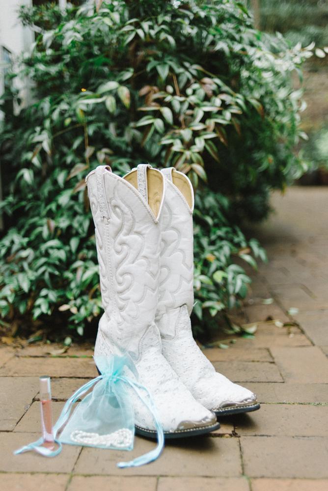 Leach-botanical-gardens-wedding-cowgirl-boots-perfume-pearls.jpg