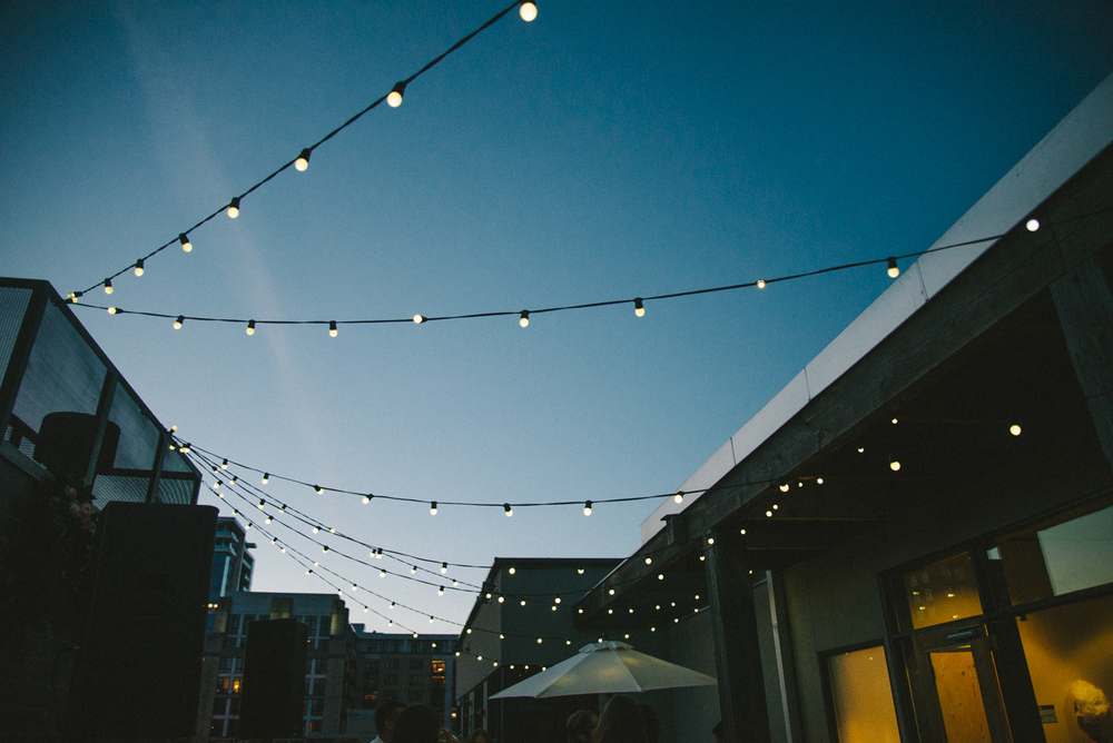 ecotrust-building-wedding-reception-sting-lights-bulbs-cityscape-portland-oregon-shelley-marie-photo