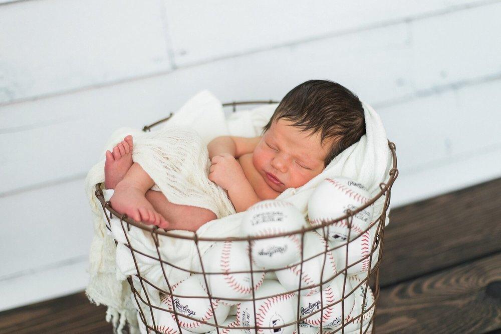 portland-oregon-newborn-photographer-sleeping-baby-boy-bucket-of-baseballs-basket-shelley-marie-photography.jpg