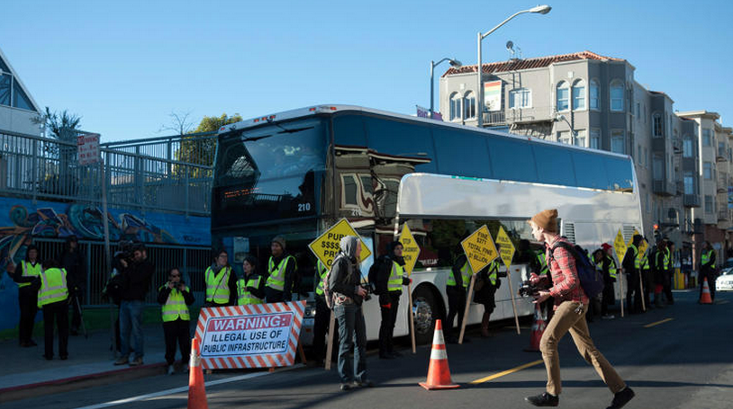 Anti-gentrification protesters in San Francisco block the Google shuttle.