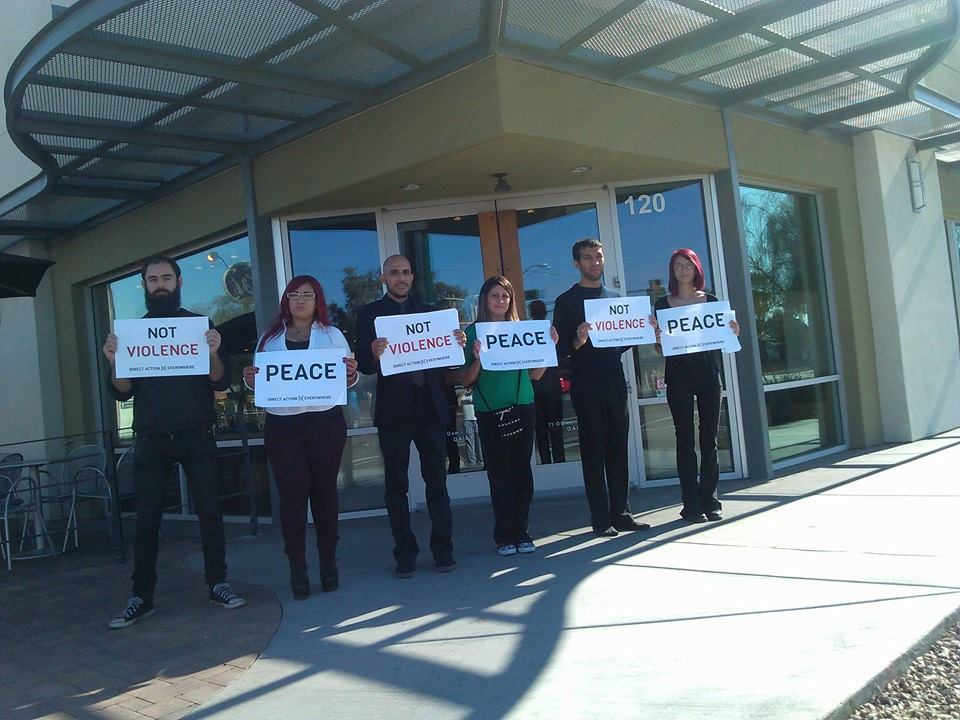 Mathias (on the far left) with DxE in Phoenix, protesting Chipotle.