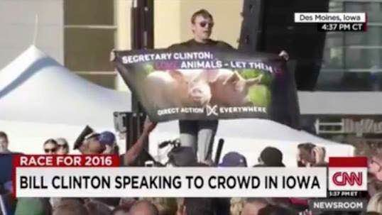 Matt disrupting a Bill Clinton speech with a message of animal liberation