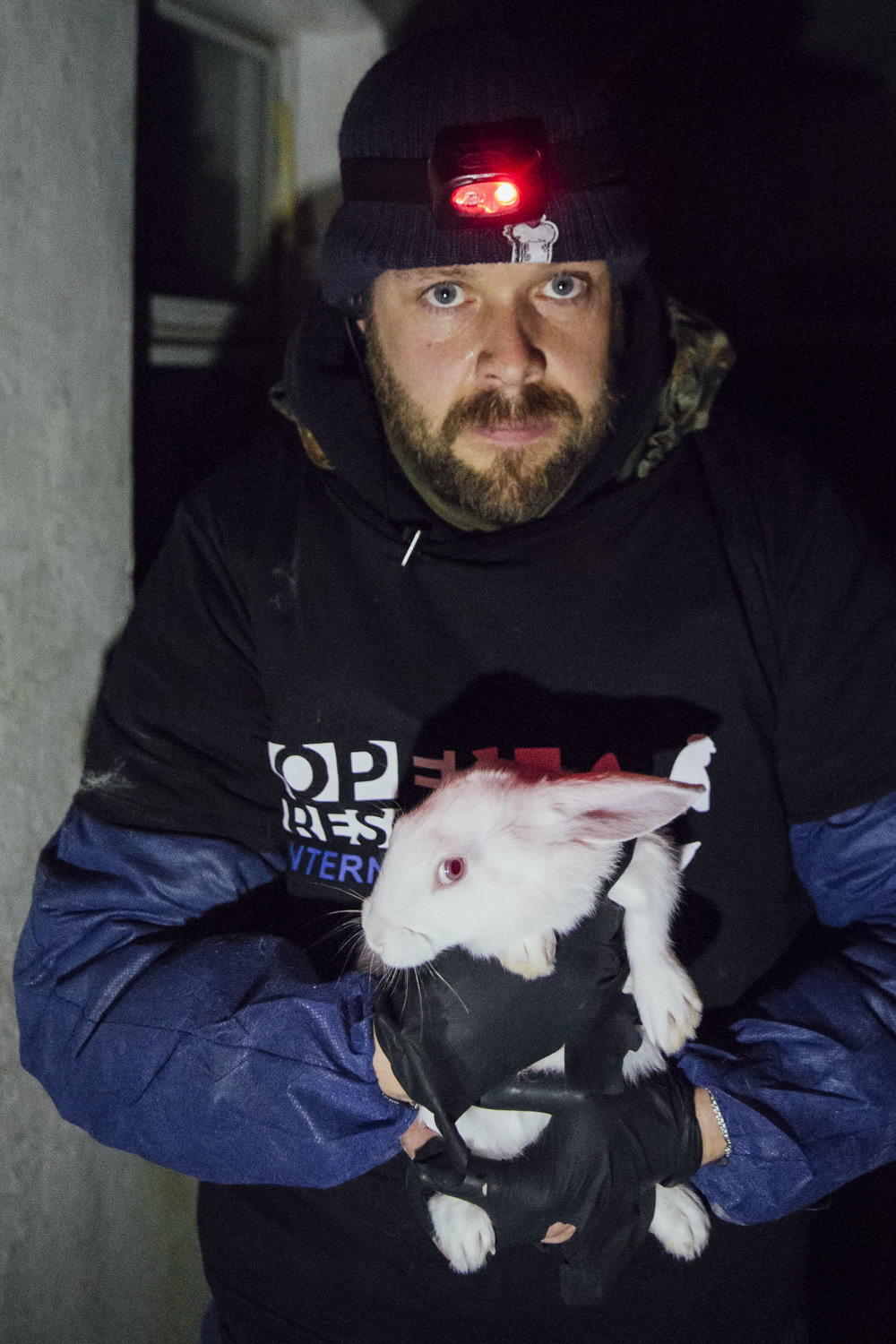 An activist from Tierretter.de in Germany holds a rescued rabbit