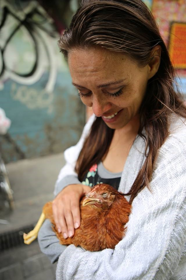Activist Julianne Perry holds one of the six rescued chickens