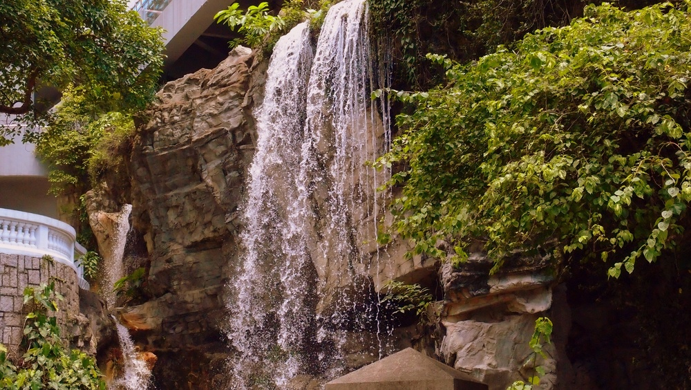 To get to the Conservatory go through the waterfall