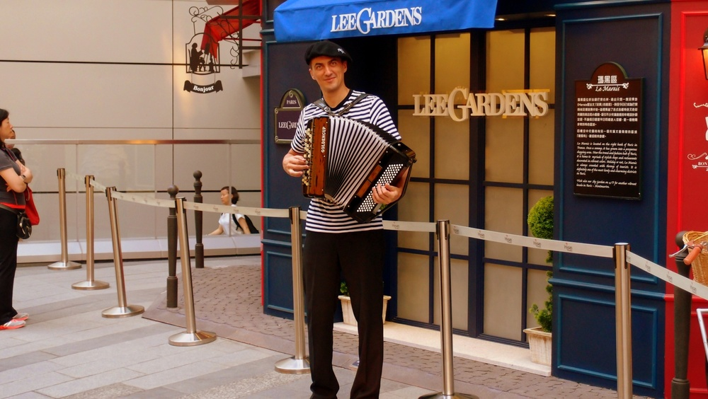 A French dude playing the accordion