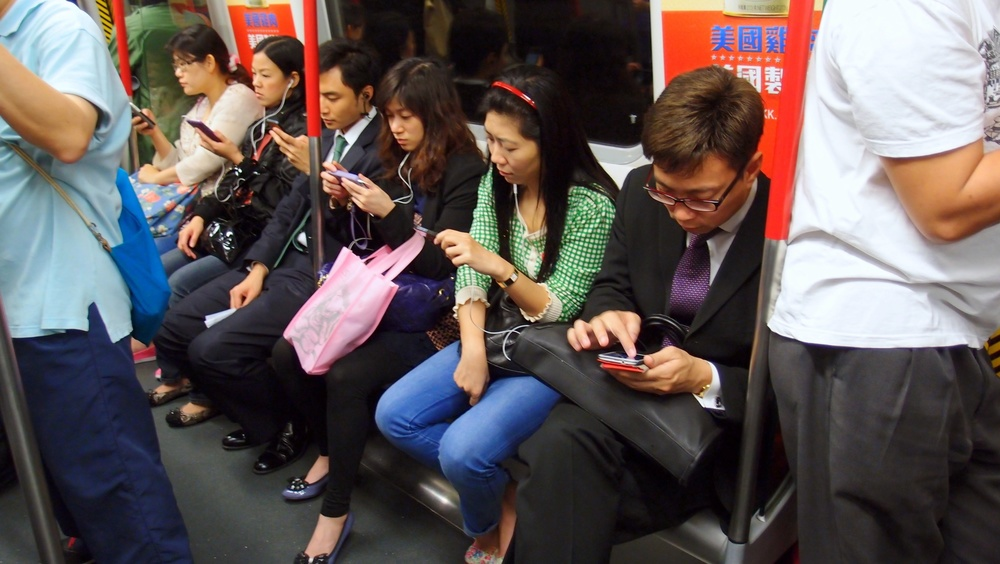 I imagine this scene is played out in all cities, citizens using their smart phones, nobody talks anymore!
