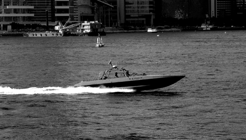 The Marine Police here have watched too much Miami Vice