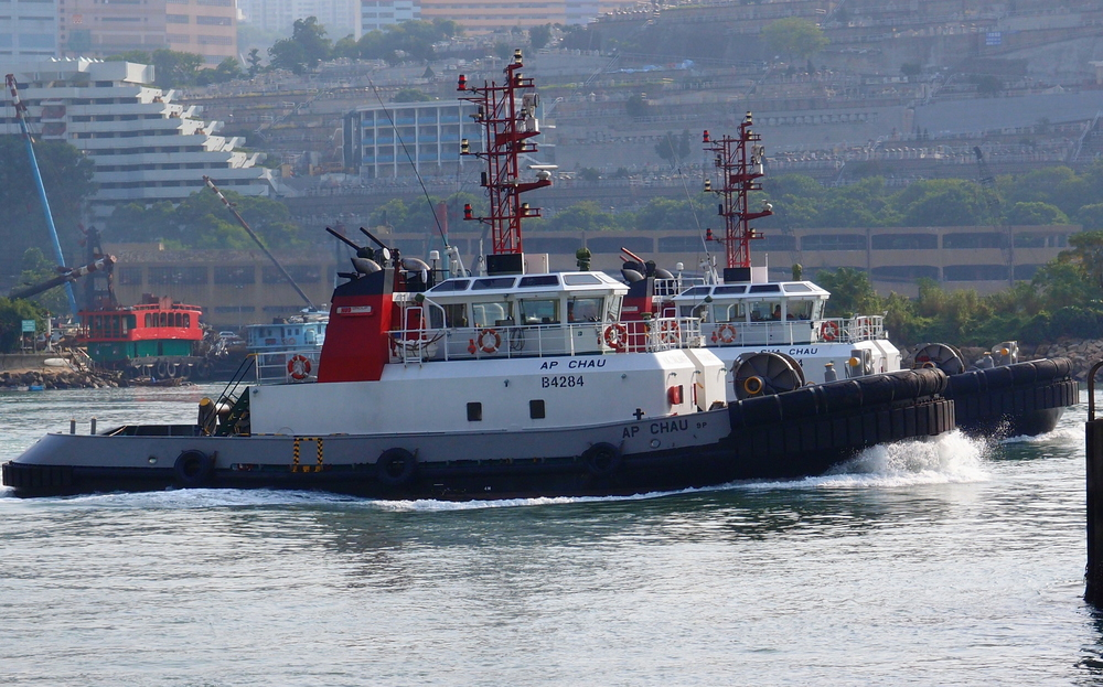Tugs racing each other in Tsing Yi harbour