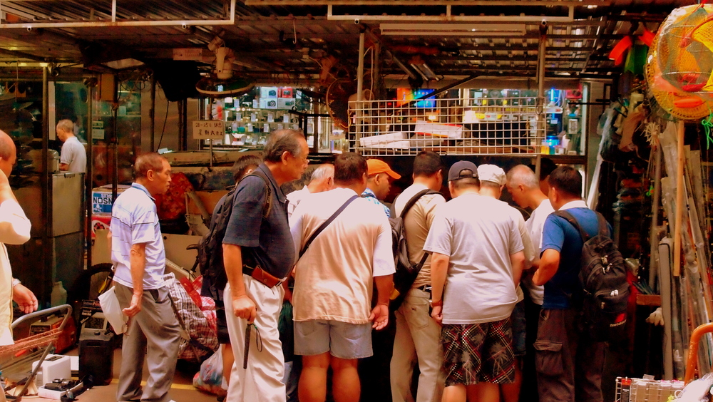 They were looking at an old radio! - a local market in Sham Shui Po