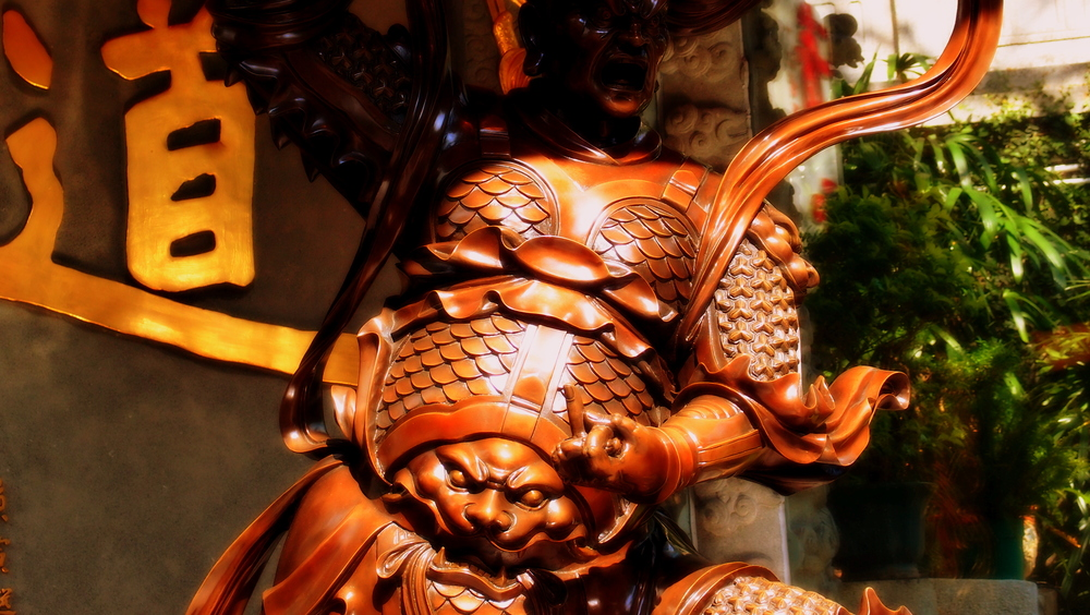 An angry god / beast at the Sik Sik Yuen Wong Tai Sin Temple showing his displeasure.