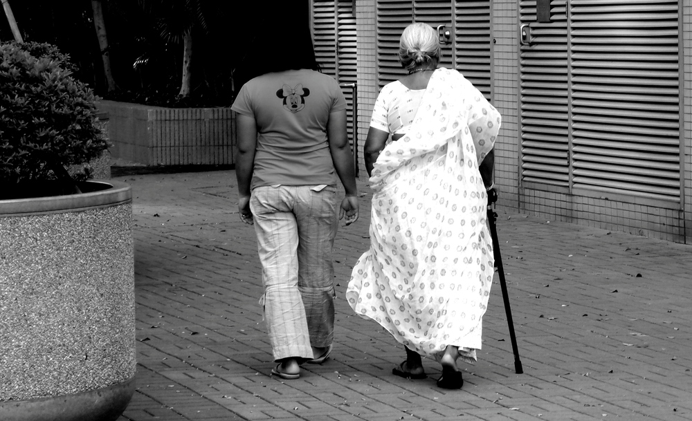 A maid walking her employer