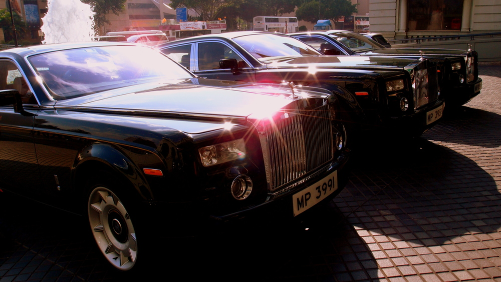 Just part of the fleet of Rolls Royce Phantoms at the Peninsula Hotel - travel in style to and from the airport.