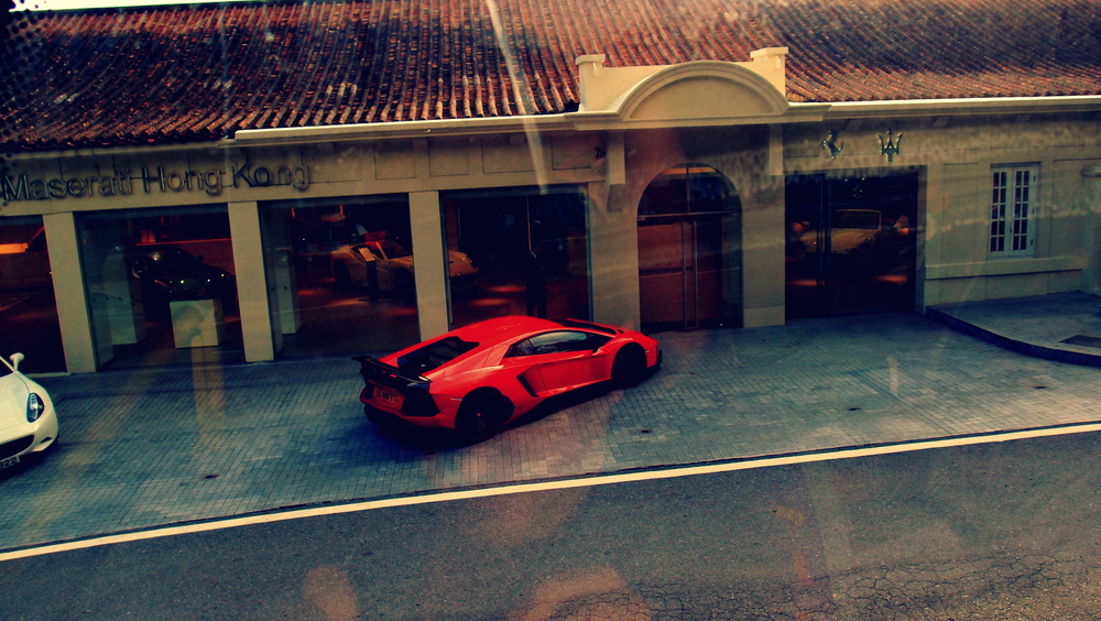 Me thinks the driver of the Lamborghini popped into the showroom to buy a Ferrari and a Maserati and why not.
