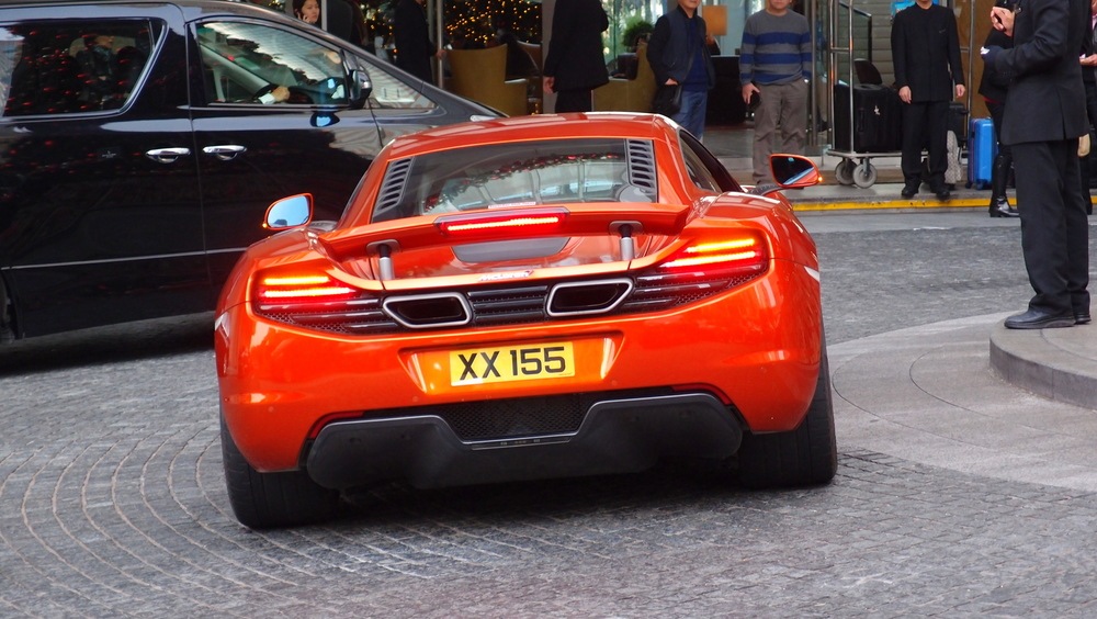 Oh lordy, an orange McLaren at the Four Seasons Hotel in Central