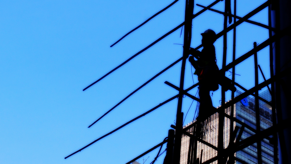 Sometimes a picture just comes together, a bamboo scaffolder doing his thing at HSBC Headquarters.