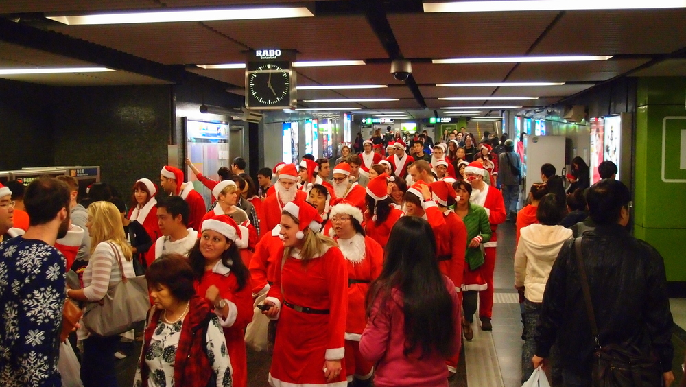 Invasion of the Santa body snatchers at TST MTR Station in Kowloon