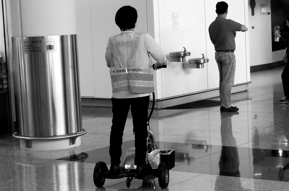 "The cleaners at the airport zip about on these rather peculiar ""Segway"" type vehicles."