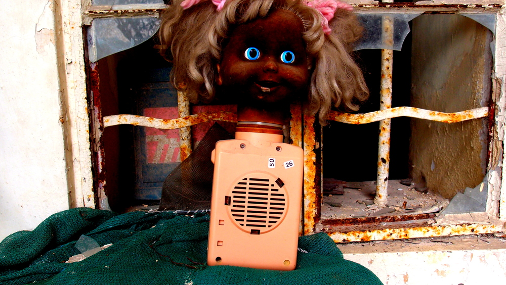 """Very, very creepy - a somewhat bizarre doll sat """"rusting"""" away at the 10,000 Buddha Monastery"""
