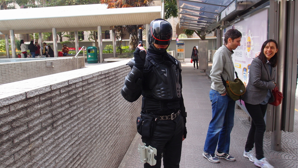 We quite often get idiots walking around the streets of Hong Kong in fancy costume - this nutter dressed as Robocop is liable to get himself shot dead if he wafts the gun around near a copper, they are not known for their sense of humour when it comes to guns!