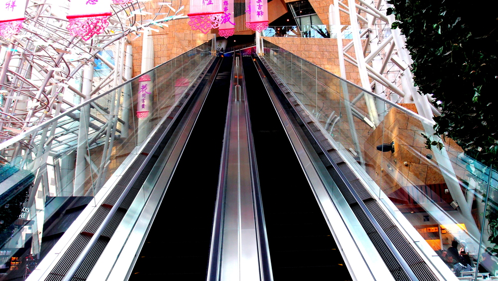 This is a very long escalator in the Langham Place Mall in Mongkok