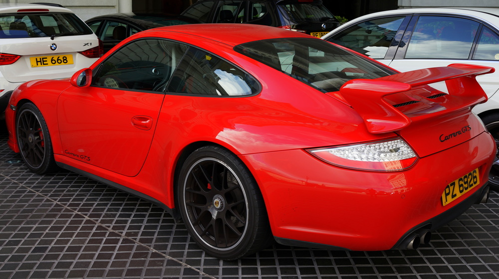 A very sweet car, the Porsche Carrera GTS, parked at the Peninsula Hotel