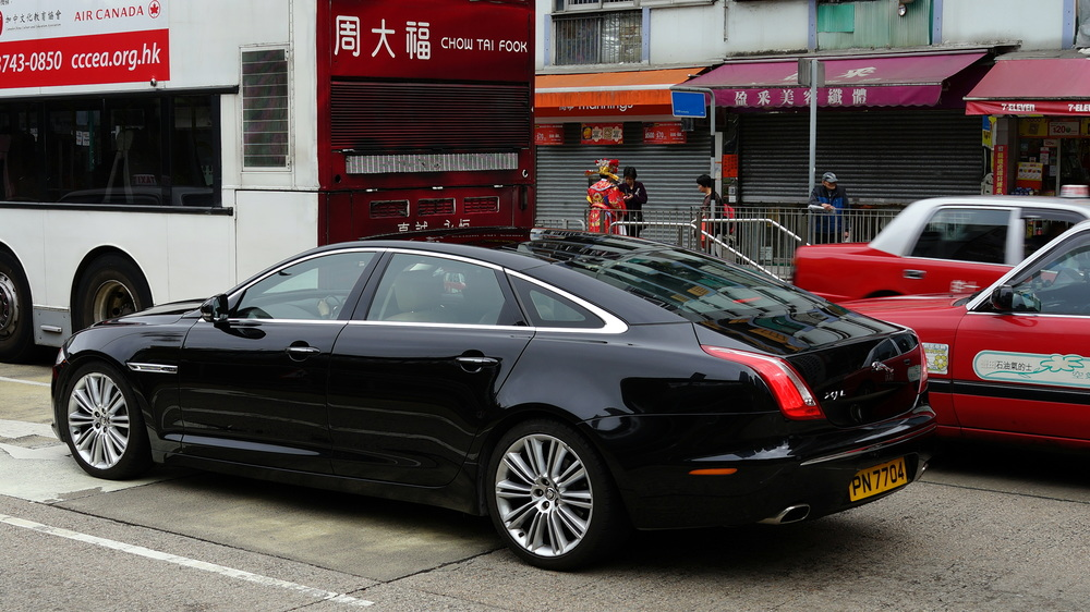 A nice Jaguar in Ngau Tau Kok - note the bloke in a Chinese New Year costume in the background - probably a politician!