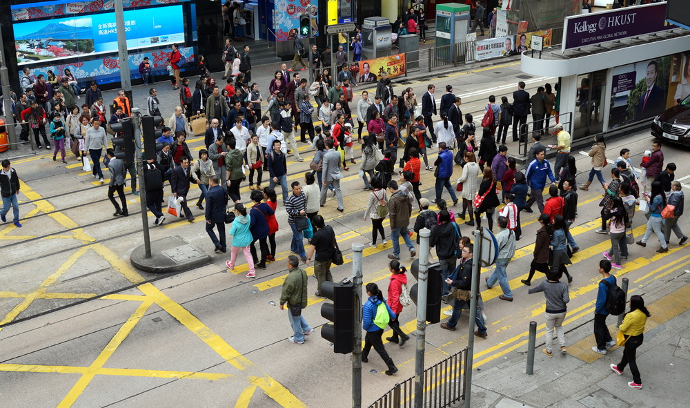 The very busy intersection at Des Voeux  Road and Pedder Street in Central on Hong Kong Island.