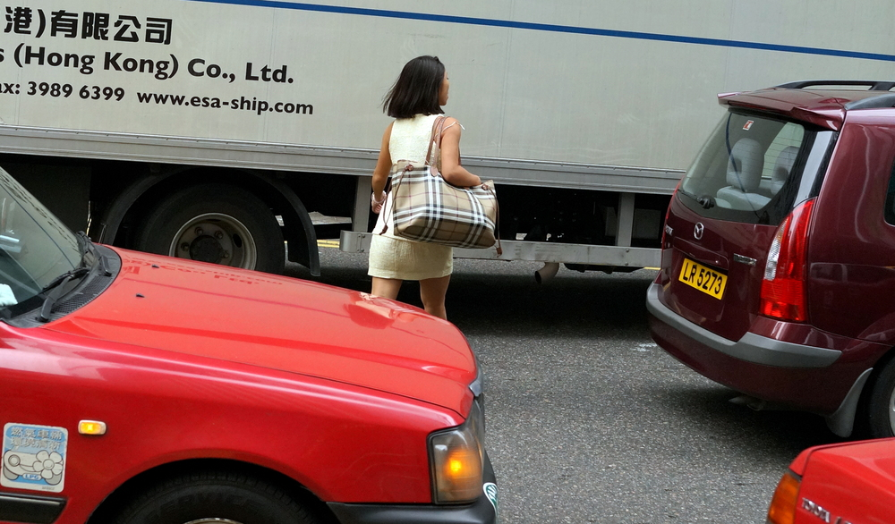 This attractive and rather fit young lady managed to stop traffic and zip across the road - she could have just as easily been squished.