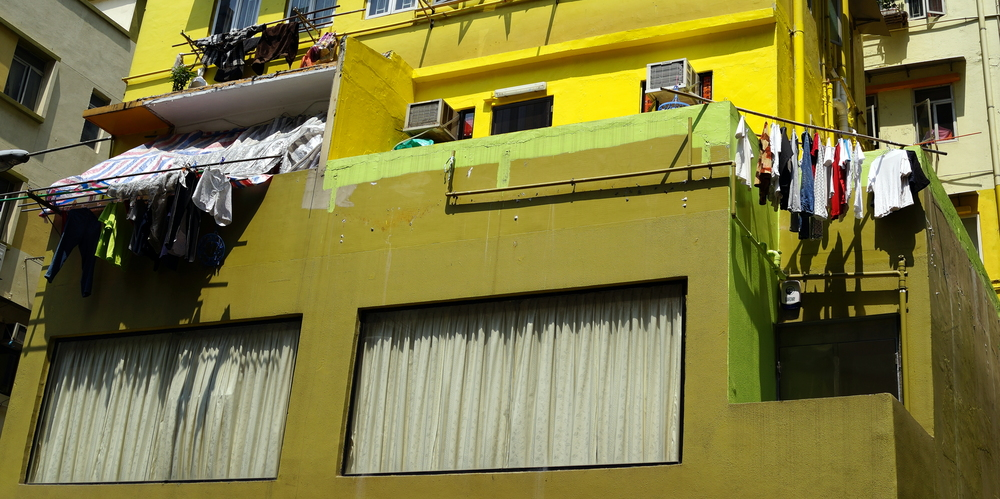 Laundry drying at a very colourful building at the Sheung Wan end of Hollywood Road