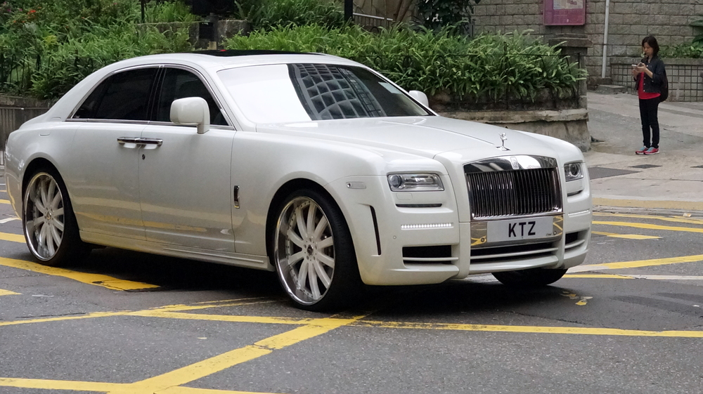 A somewhat more modern Rolls Royce, pimped out and also a nice number plate.