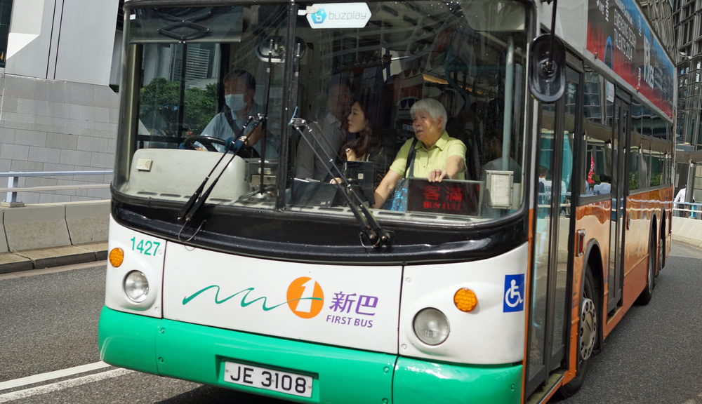 Bus no. 23 that runs on Hong Kong Island continues to pack them in despite there being a bus every 7 - 8 minutes - it is never comfortable standing like this.