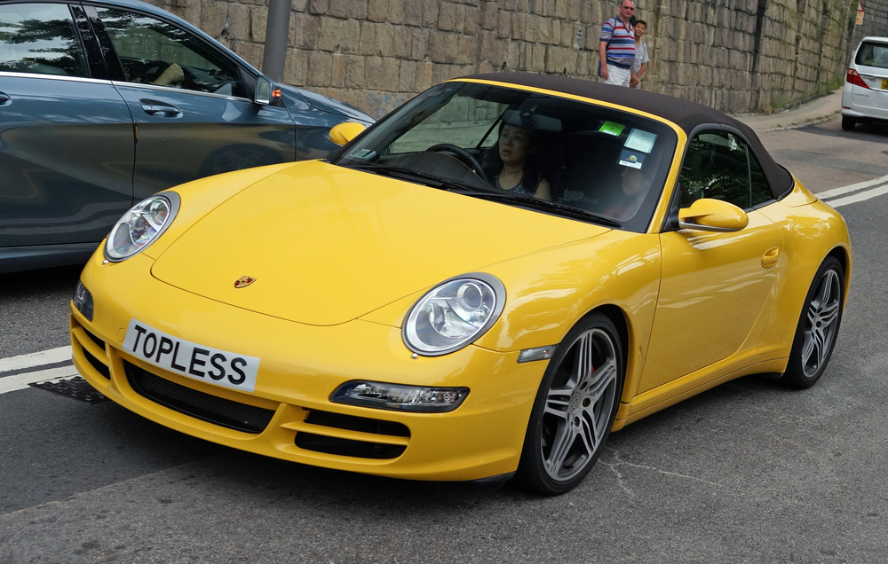 This is one of my most popular images ever on my Flickr site - a rather lovely yellow Porsche with the rather interesting number plate!